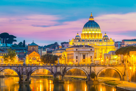 basilica of saint peter: Night view of old roman Bridge of Hadrian and St  Peter s cathedral in Vatican City Rome Italy  Stock Photo
