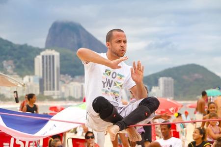 contestant: RIO DE JANEIRO - NOVEMBER 03 2012  Slackline contestant on the sands of Copacabana in Rio Elephant Cup tournament, held on November  03, 2012 on Copacabana, Rio de Janeiro, Brazil