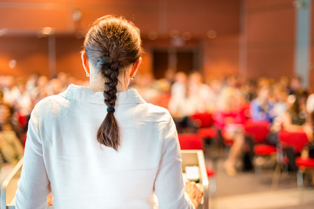 Female academic professor lecturing at Conference  Audience at the lecture hall