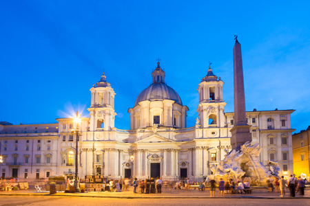 navona: Fountain of the four Rivers and SantAgnese in Agone on Navona square in Rome, Italy, Europe shot at dusk