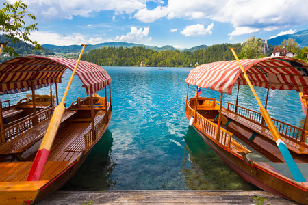 bled: Traditional wooden boats on picture perfect lake Bled, Slovenia  Stock Photo