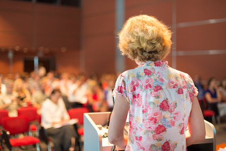 listeners: Female academic professor lecturing at Conference  Audience at the lecture hall