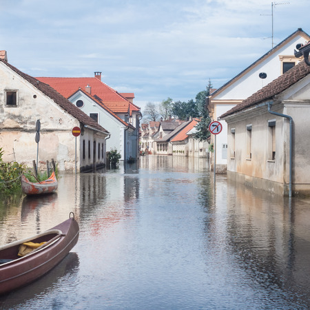 Rural village houses in floodwater.  photo
