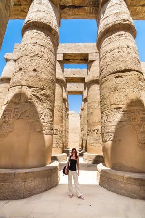 thebes: Female tourist in Ancient Egyptian Temple of Karnak (ancient Thebes). Luxor, Egypt. Stock Photo