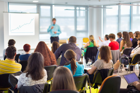 teach: Speaker at business workshop and presentation with Audience at the conference room. Stock Photo
