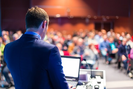 conference: Speaker at Business Conference and Presentation. Audience at the conference hall. Stock Photo