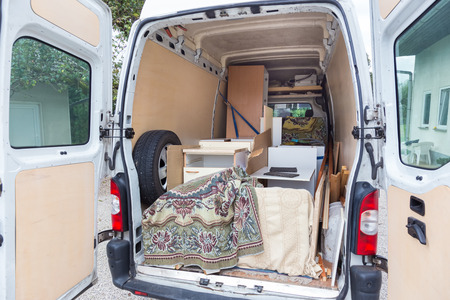 removal van: Interior of A Moving Van On Street With Household Furnishings.