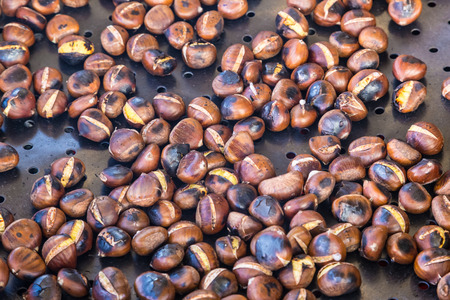 marron: Grilled chestnuts being selled at stalls in autumn.