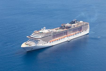 Luxury cruise ship sailing in Mediterranean sea.