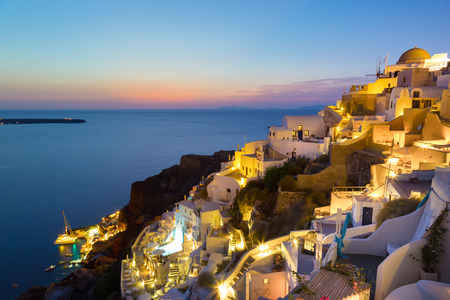 roof light: World famous traditional whitewashed chuches and houses of Oia village on Santorini island, Greece. Sunset.