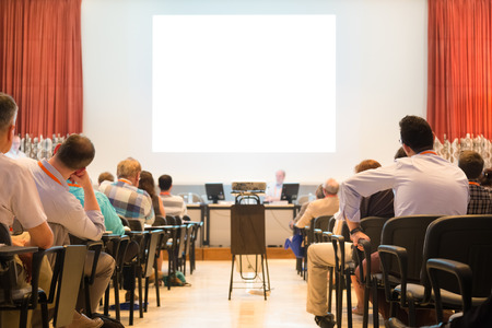 academy: Speaker at Business Conference and Presentation. Audience at the conference hall. Business and Entrepreneurship. Stock Photo