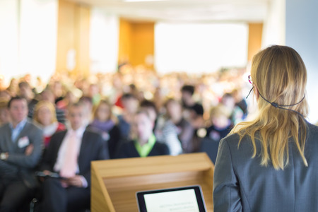 Female speaker at Business Conference and Presentation. Audience at the conference hall. Business and Entrepreneurship. Business woman. photo