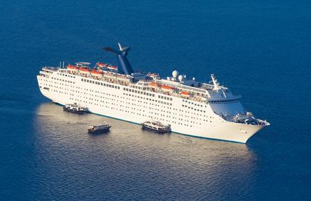 ship deck: Luxury cruise ship sailing around Santorini island, Aegean sea in Greece. Stock Photo