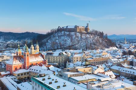 ljubljana: Panoramic view of Ljubljana, capital of Slovenia. Roofs covered in snow in winter time.