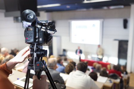 conference hall: Business Conference and Presentation. Audience at the conference hall. Television broadcasted press conference. Stock Photo