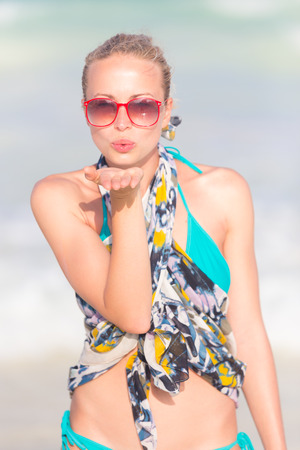 hot lips: Lady sending a kiss from summer vacations. Stock Photo