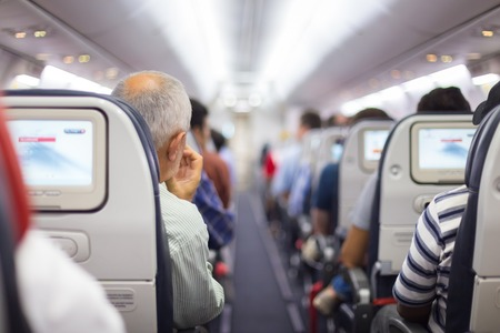 Interior of airplane with passengers on seats waiting to taik off. 版權商用圖片 - 37072008