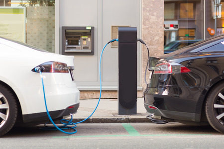 Power supply for electric car charging.  Electric car charging station. Éditoriale