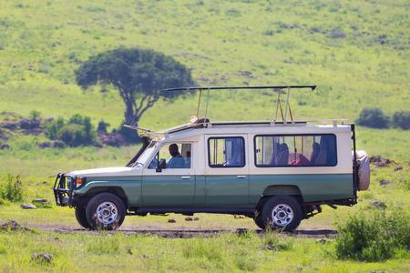 Open roof 4x4 safari jeep on african wildlife safari.