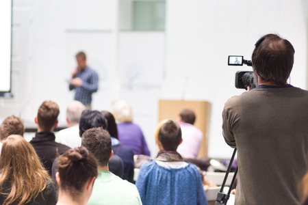 press media: Business Conference and Presentation. Audience at the conference hall. Television broadcasted press conference. Stock Photo
