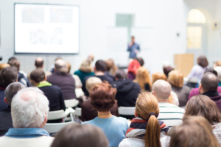 public speaker: Speaker Giving a Talk at Business Meeting. Audience in the conference hall. Business and Entrepreneurship. Copy space on white board.