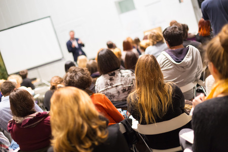 Speaker Giving a Talk at Business Meeting. Audience in the conference hall. Business and Entrepreneurship. Copy space on white board. Stock Photo - 38671904