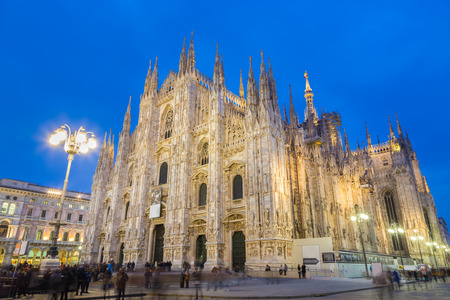 Milan Cathedral, Duomo di Milano, is the gothic cathedral church of Milan, Italy. Shot in the dusk from the square ful of people.