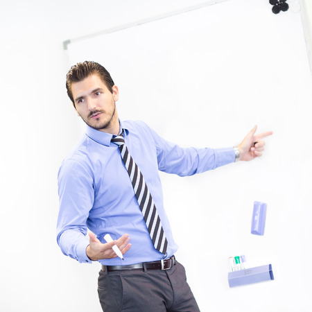 present presentation: Business man making a presentation in front of whiteboard. Copy space.