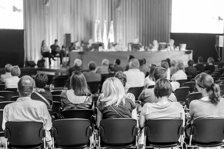 committee: Trade union advisory committee meeting . Audience at the conference hall. Black and white shot.
