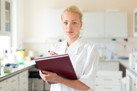 health care professional: Portrait of an attractive, young, confident female health care professional in his working environment.