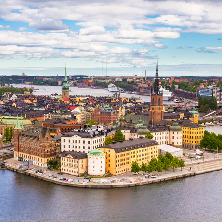 gamla stan: Panoramic view of swedish capital Stockholm seen from the city hall tower. Aerial view of Gamla stan, old medieval downtown. Square composition.