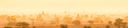 thumbnail: Temples of Bagan an ancient city located in the Mandalay Region of Burma, Myanmar, Asia. yellow toned. Thumbnail format. Vertical panoramic composition.