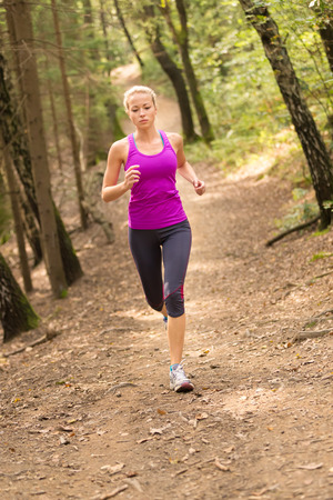 one woman: Pretty young girl runner in the forest.  Running woman. Female Runner Jogging during Outdoor Workout in a Nature. Beautiful fit Girl. Fitness model outdoors. Weight Loss. Healthy lifestyle.