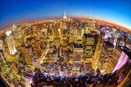 world trade center: New York City. Manhattan downtown skyline with illuminated Empire State Building and skyscrapers at dusk seen from observation deck. Panoramic fish eye view. Stock Photo