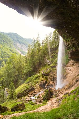 tree vertical: Beautiful natural landscape under Pericnik waterfall in Vrata Valley in Triglav National Park in Julian Alps, Slovenia. Stock Photo