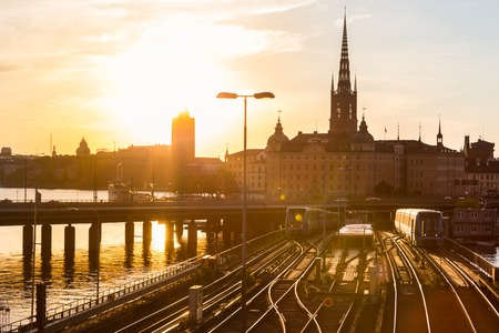 railroads: Railway tracks and trains near Stockholms main train station in Norrmalm area, Stockholm, Sweden in sunset.