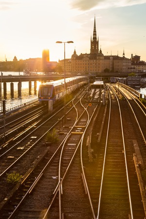 railway: Railway tracks and trains near Stockholms main train station in Norrmalm area, Stockholm, Sweden in sunset.