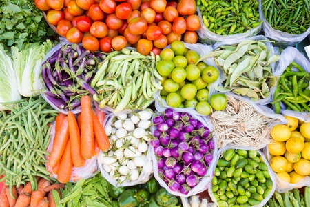 Farmers market with various domestic colorful fresh fruits and vegetable. Tasty colorful mix.