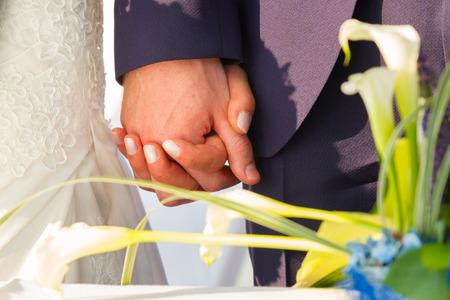 lovely couple: Wedding couple holding hands. Wedding theme, newlyweds. Stock Photo