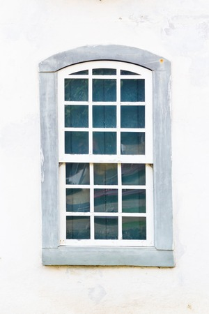 window frame: Decorative, colonial, vintage, window on a white wall in Paraty or Parati, Brazil.