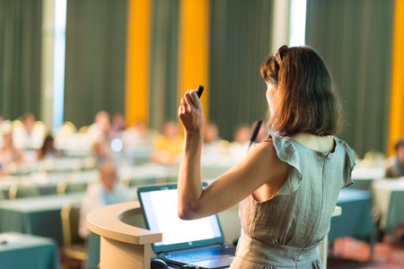 computer speaker: Business woman. Female speaker giving a talk at  business conference . Business and Entrepreneurship concept. Horizontal composition. Stock Photo