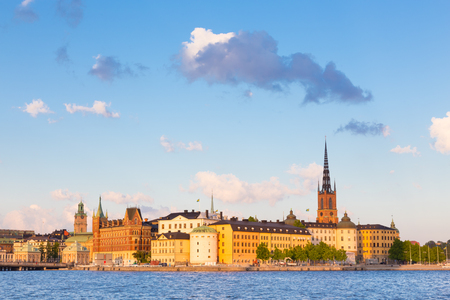 gamla stan: Panoramic view of swedish capital Stockholm in sunset. Gamla stan, old medieval downtown. Horisontal composition. Copy space. Stock Photo