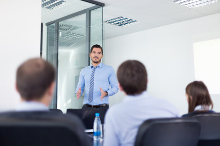 recruiters: Business man making a presentation in office on job interview. Business presentation on corporate meeting. Recruiters evaluating the candidate.