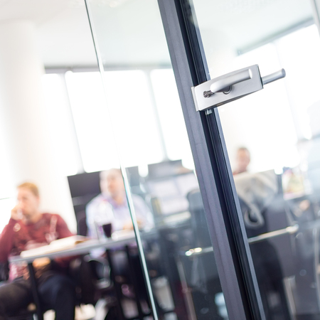 Trough Glass Door View Of Corporate Meeting Business And