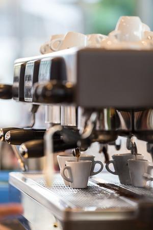 espreso: Professional coffee machine making espresso in a cafe. Stock Photo