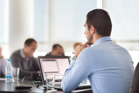 executive: Corporate business meeting in office. Business executive giving instructions to his colleagues. Explaining business plans to employees. Business team concept. Business and Entrepreneurship. Stock Photo