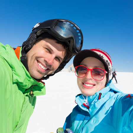 alp: Selfie of couple skiers on winter vacations in the Alp mountains, Triglav natural park, Vogel, Slovenia.