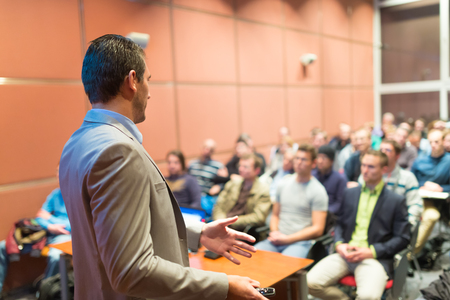 public speaker: Speaker at Business Conference with Public Presentations. Audience at the conference hall. Business and Entrepreneurship concept. Background blur. Shallow depth of field.