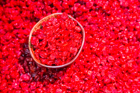 dried food: Scoop of dried cranberries beeing sold on local food market. Stock Photo