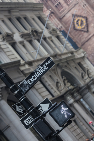 trafic: New York stock exchange street sign and go trafic light on a semaphore in New York City, USA. Invest. Bull market ahead. Stock Photo